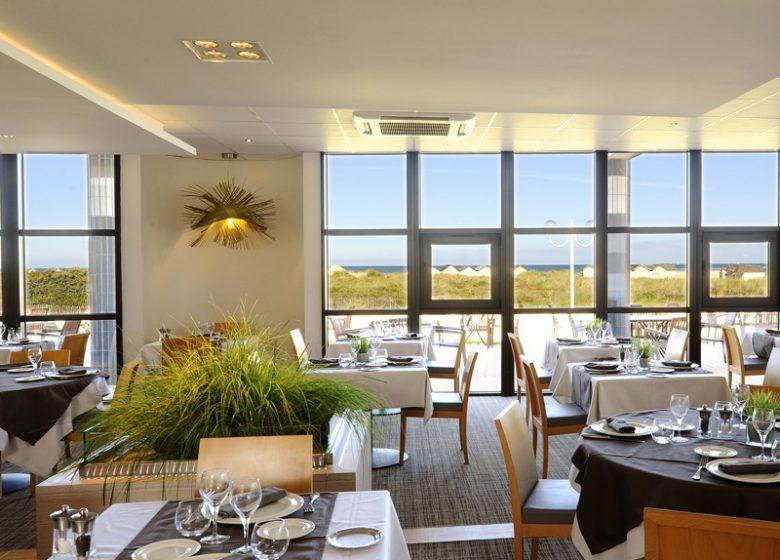 Salle du restaurant de l'hôtel Riva Bella